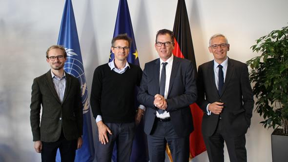 Friedrich Püttmann, Gerald Knaus, Minister Gerd Müller, State Secretary Martin Jäger. Photo: Bundesministerium für wirtschaftliche Zusammenarbeit und Entwicklung