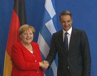 Angela Merkel and Kyriakos Mitsotakis